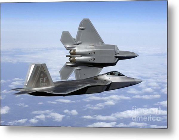 Metal Print featuring the photograph Two F-22a Raptors In Flight by Stocktrek Images