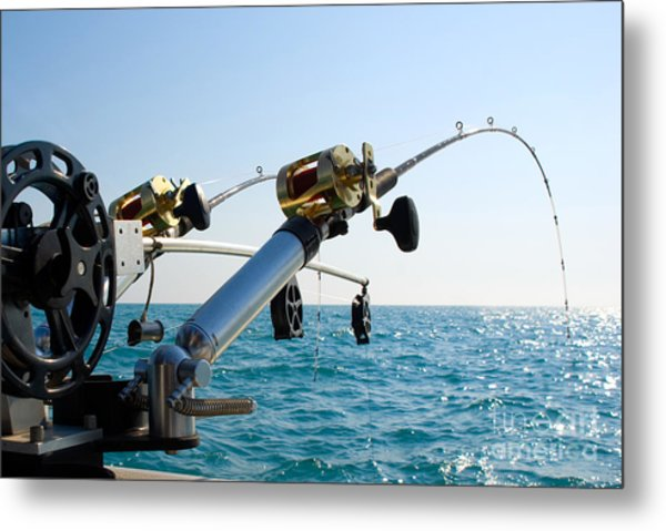Two Fishing Poles On Back Of Boat Metal Print by Paul Velgos