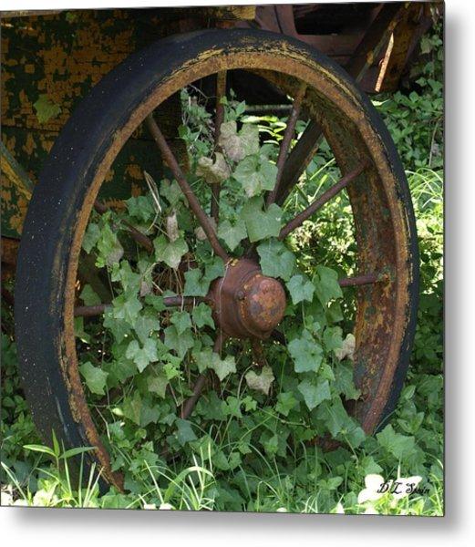 Wagon Wheel Metal Print by Dennis Stein