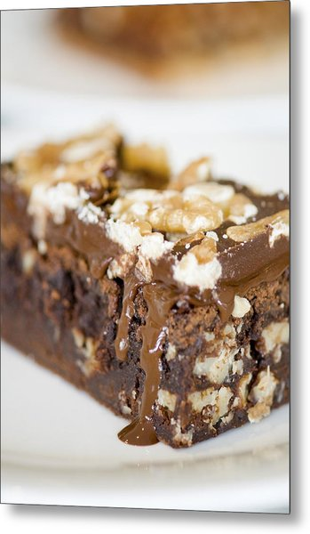 Walnut Brownie On A White Plate Metal Print