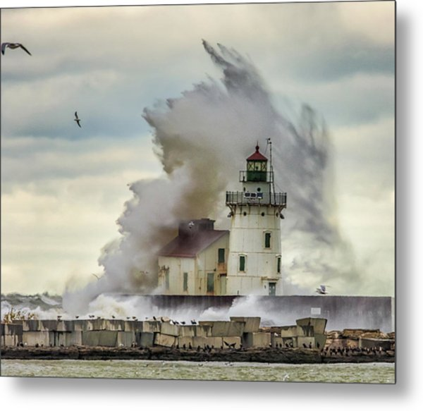 Waves Over The Lighthouse In Cleveland. Metal Print