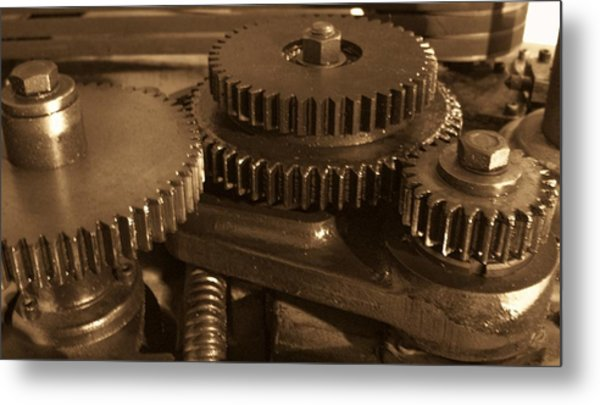 What Makes The World Go Around Metal Print by Robert  Collier