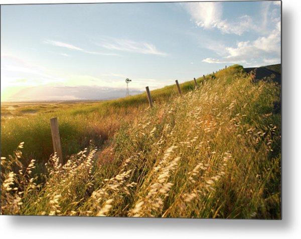 Windmill And The Fence Sundown Metal Print