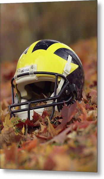 Metal Print featuring the photograph Wolverine Helmet In October Leaves by Michigan Helmet