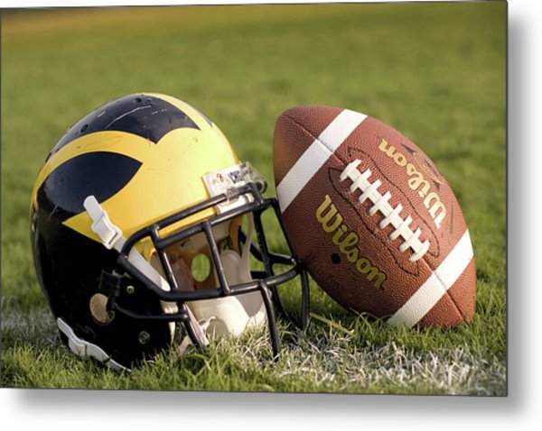 Wolverine Helmet With Football On The Field Metal Print