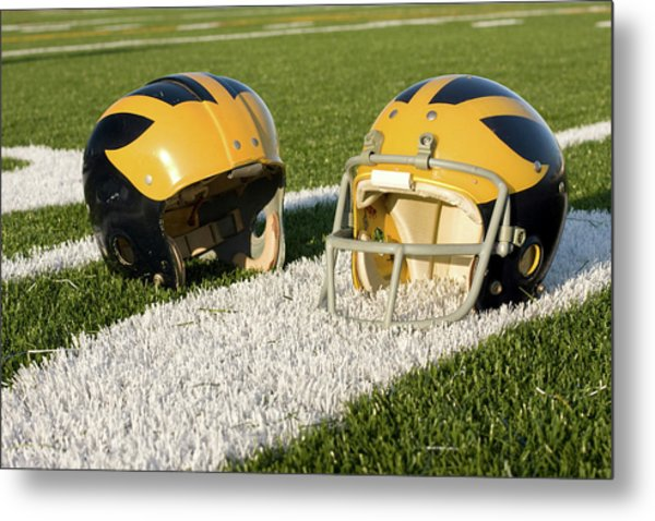 Metal Print featuring the photograph Wolverine Helmets From Different Eras On The Field by Michigan Helmet