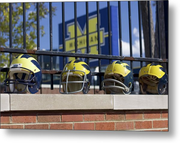 Wolverine Helmets Of Different Eras On Stadium Wall Metal Print