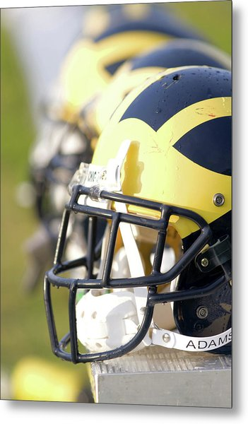 Metal Print featuring the photograph Wolverine Helmets On A Bench In The Morning by Michigan Helmet