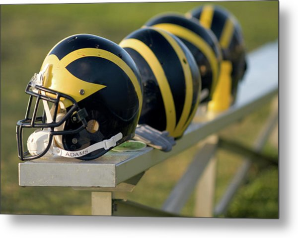 Metal Print featuring the photograph Wolverine Helmets On A Bench by Michigan Helmet