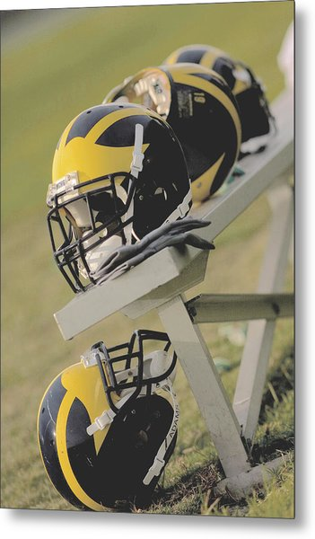 Metal Print featuring the photograph Wolverine Helmets On A Football Bench by Michigan Helmet