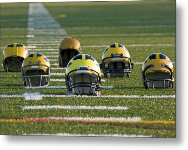 Metal Print featuring the photograph Wolverine Helmets Throughout History On The Field by Michigan Helmet