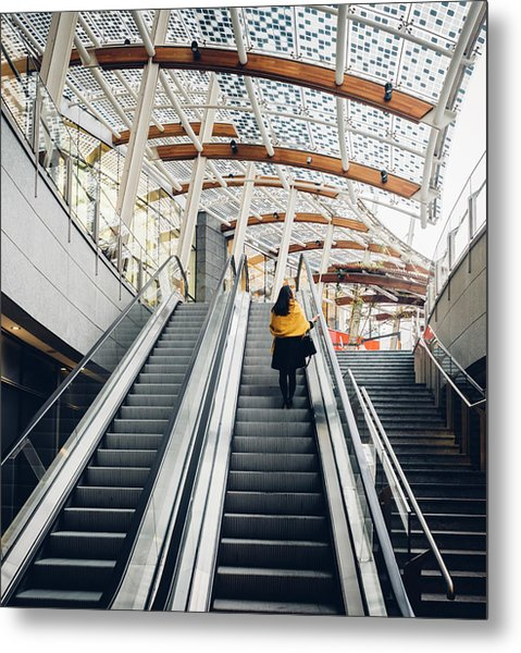 Woman Going Up Escalator In Milan, Italy Metal Print