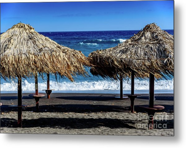 Wood Thatch Umbrellas On Black Sand Beach, Perissa Beach, In Santorini, Greece Metal Print