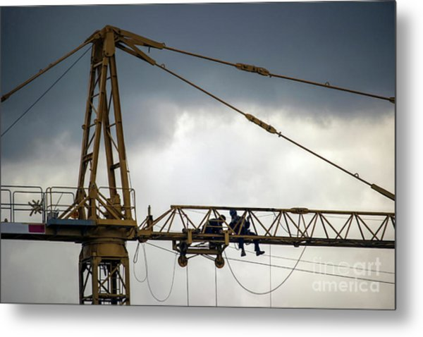 Workers Repairing A Construction Crane High Above The Ground Metal Print