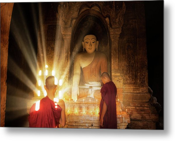 Young Buddhist Monk Are Reading With Sun Light Metal Print by Anek Suwannaphoom