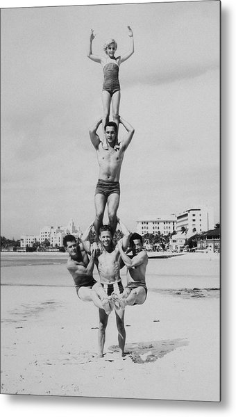Men And Girl Perform Acrobatics On Beach Metal Print