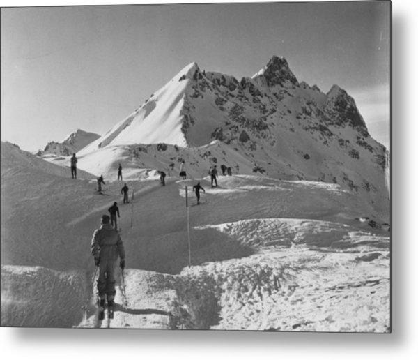 Uphill Skiers Metal Print by Bert Hardy