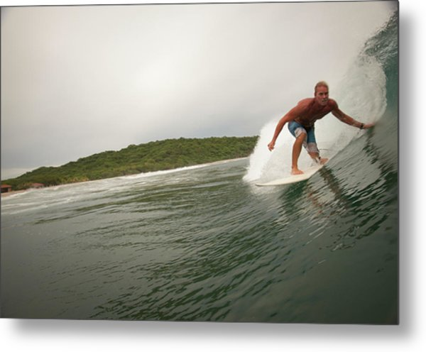 A Male Surfer In A Barrel Of A Wave In Metal Print