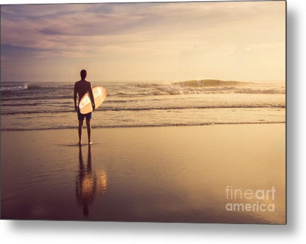 A Man Is Standing With A Surf In His Metal Print