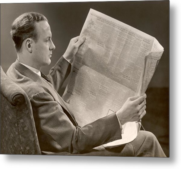 A Man Reads A Newspaper Metal Print by George Marks