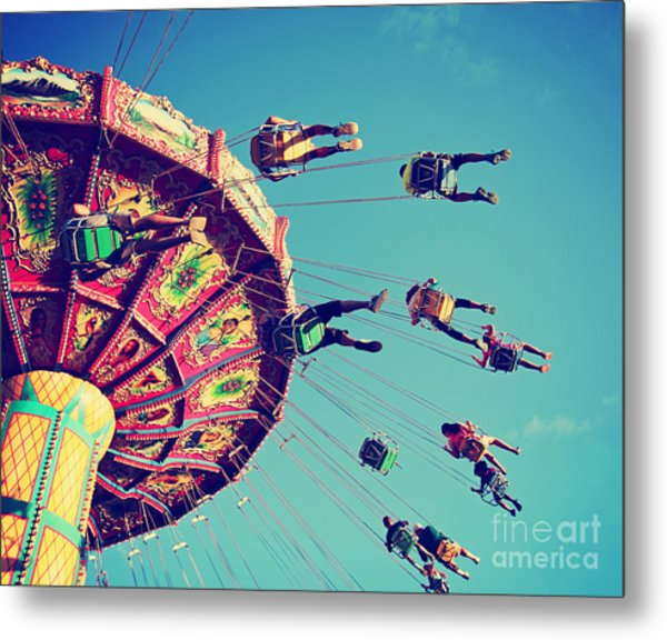 A Swinging Fair Ride At Dusk Toned With Metal Print