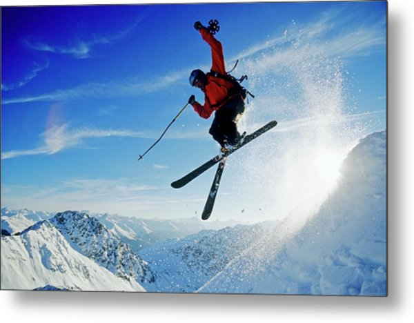 A Young Skier, A Freerider Jumping Over Metal Print