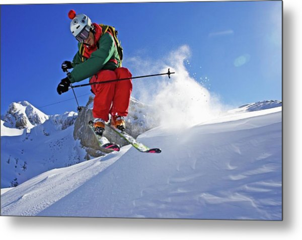 A Young Skier, A Freerider Jumps Over A Metal Print