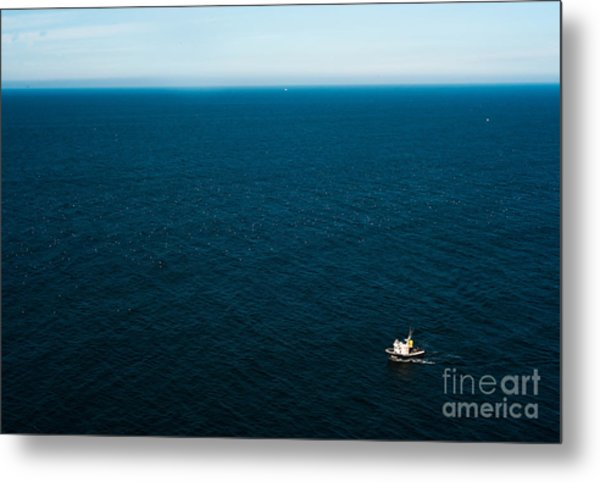 Aerial View Of A Lonely Boat In The Metal Print