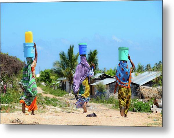 African Women Go To Fetch Water W Metal Print by Volanthevist