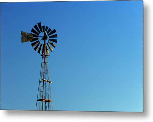 Agricultural Windmill Against Blue Sky Metal Print