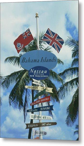 Bahamas Signpost Metal Print by Slim Aarons