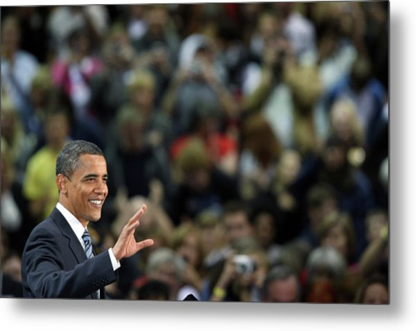 Barack Obama Campaigns In Golden Metal Print by John Moore