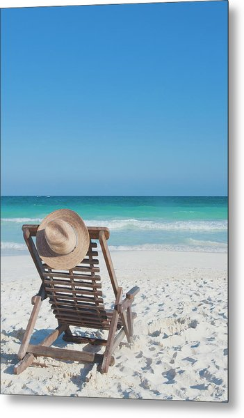 Beach Chair With A Hat On An Empty Beach Metal Print