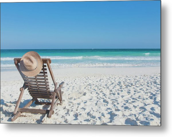 Beach Chair With A Hat, On An Empty Metal Print