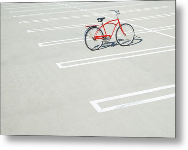 Bike In Empty Parking Lot Metal Print by Peter Starman