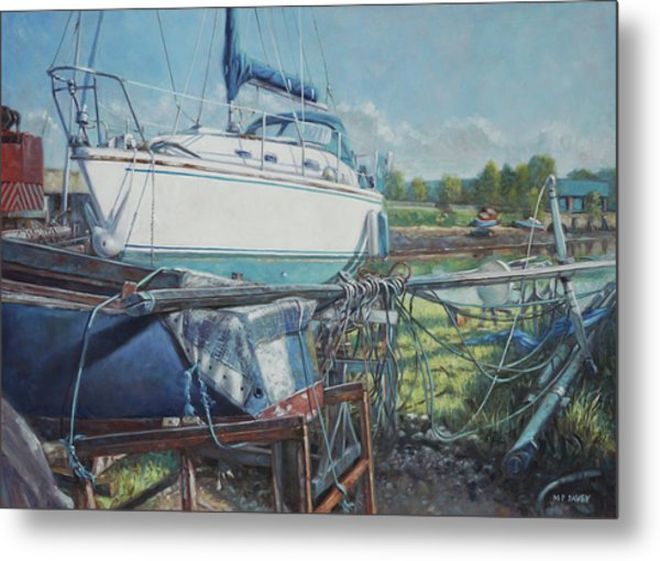 Boat Out Of Water With Dumped Parts At Marina Metal Print by Martin Davey