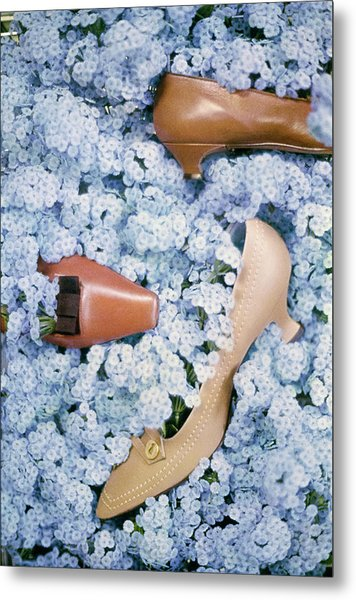Brown Shoes In Bed Of Blue Flowers Metal Print by Gordon Parks