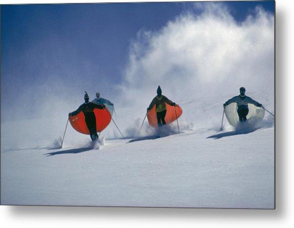 Caped Skiers Metal Print by Slim Aarons