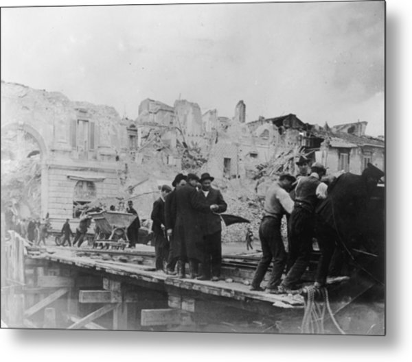 Carrying Off Debris Metal Print by Hulton Archive