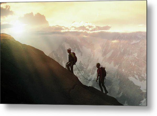 Climbers On A Mountain Ridge Metal Print by Buena Vista Images