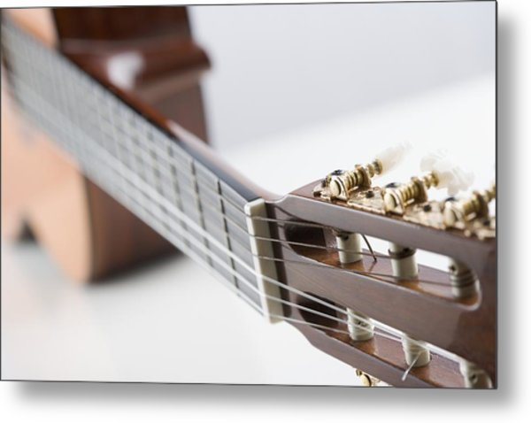 Close-up Of A Guitar Metal Print by Jamie Grill