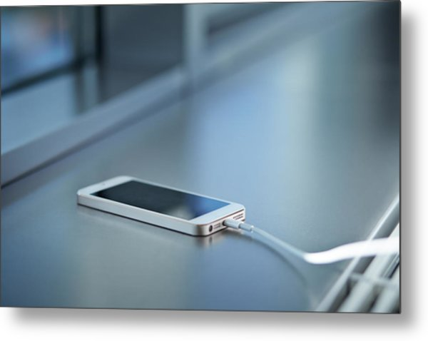 Close-up Of Smartphone Charging Metal Print by Klaus Vedfelt