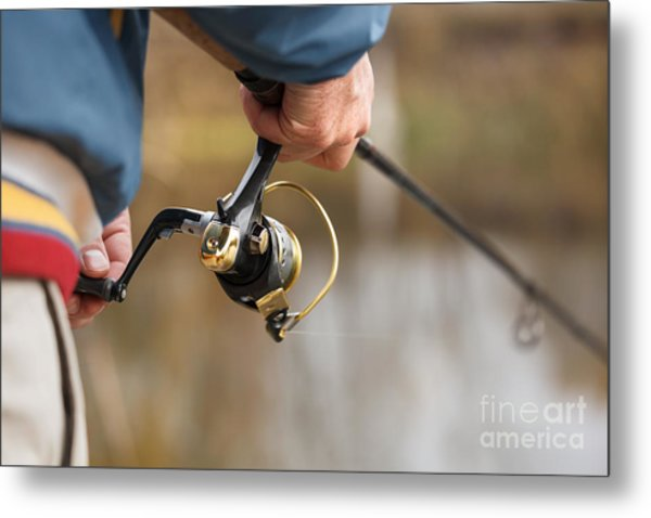 Closeup Of Fisherman`s Hand With Metal Print