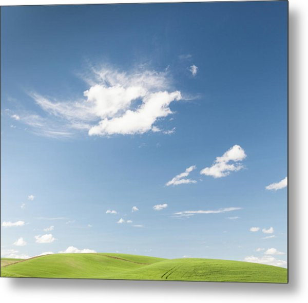 Clouds Over Green Hills Metal Print by Adrian Studer