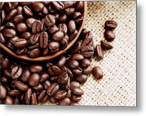 Coffee Beans Spilling From Wooden Bowl Metal Print by Joseph Clark