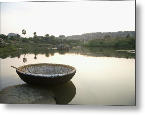 Coracle At The Bank Of A River Metal Print by Exotica.im