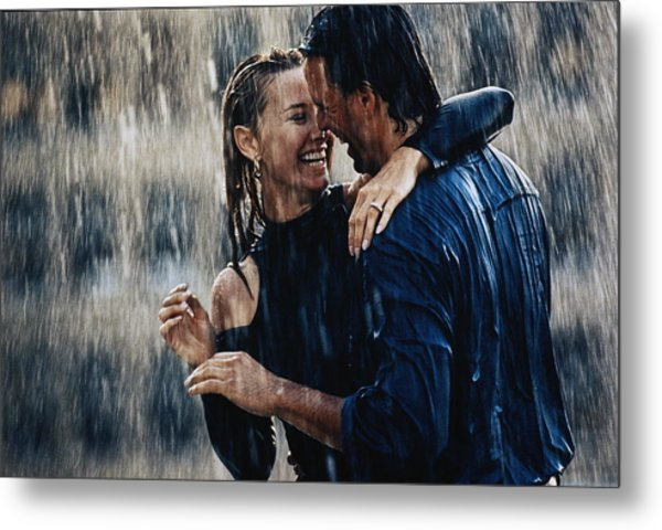 Couple Embracing In Pouring Rain Metal Print