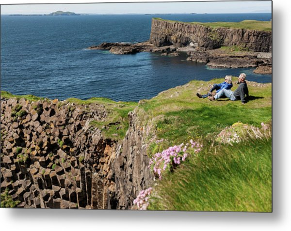 Couple Relaxing In Grass On Cliff Metal Print
