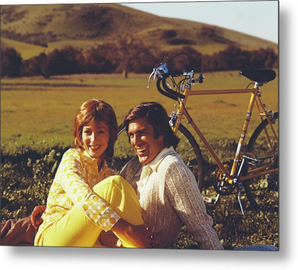 Couple Sitting In Field With Bicycle Metal Print