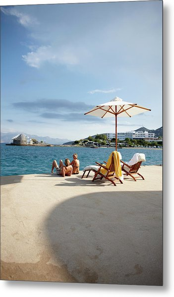 Couple Sunbathing On The Terrace Of The Metal Print